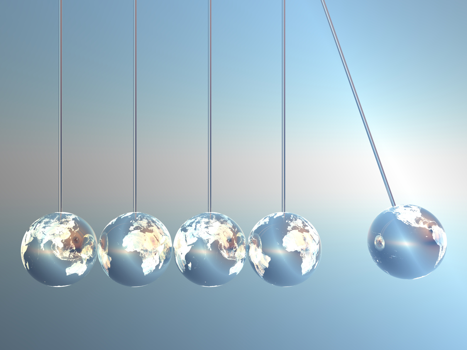 Newton cradle pendulums in Earth-Look